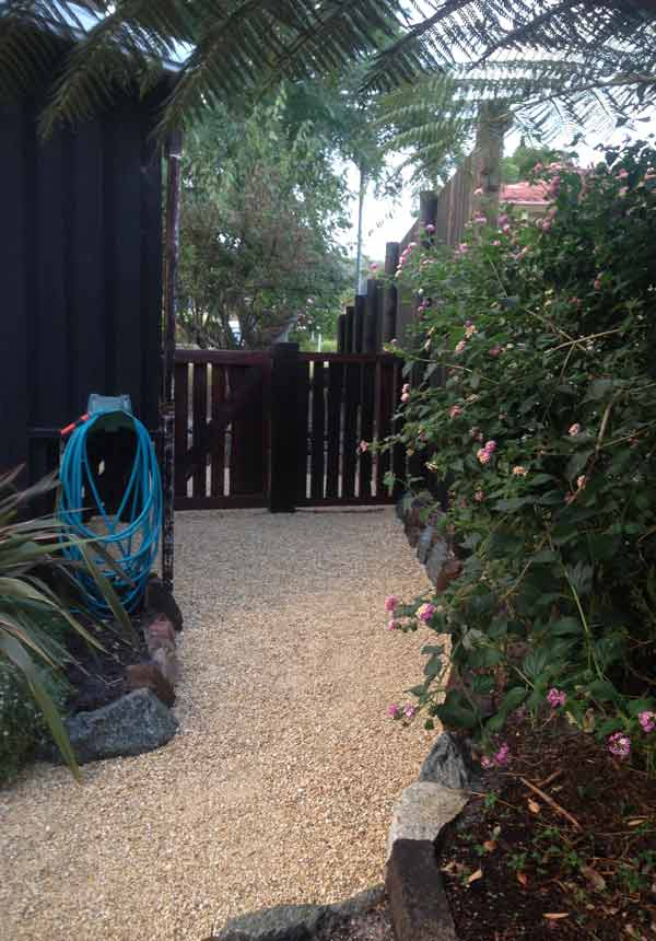 Photo of a new gate and path implemented by CCS Gardening and Maintenance