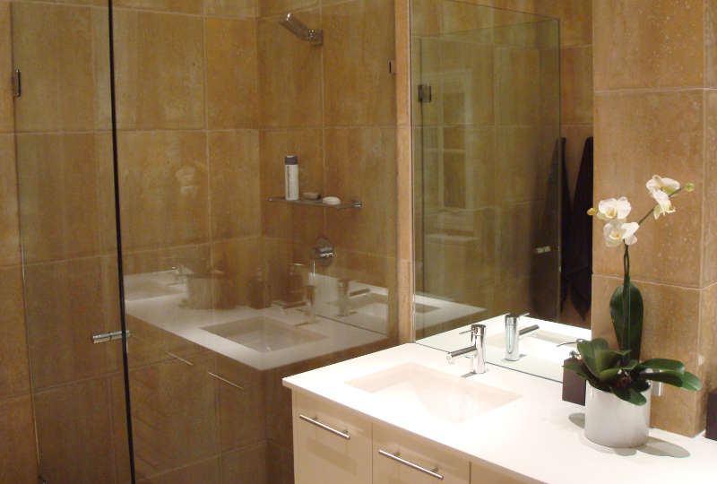 A renovated bathroom with glass shower screen.