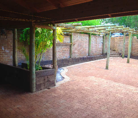 Brick paving and a wooden patio